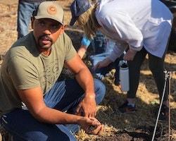 Jesse Smith holding soil