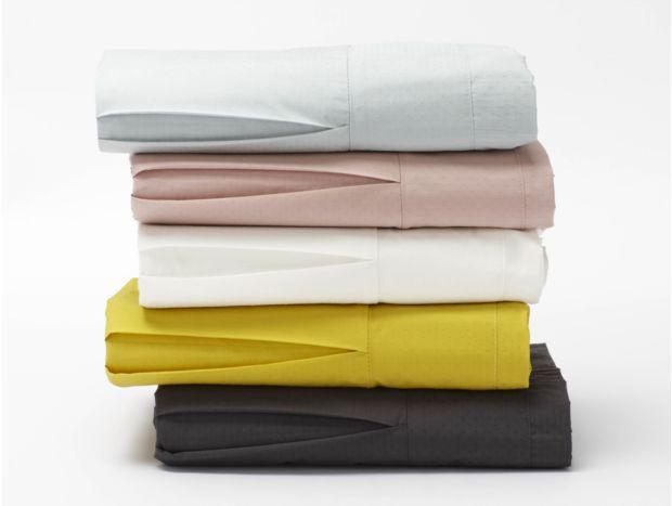 Coyuchi organic cotton crib skirt in pointille weave