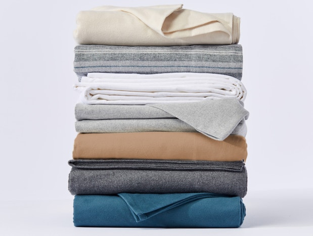 Stack of folded Cloud Brushed Organic Flannel Sheets in an array of colors