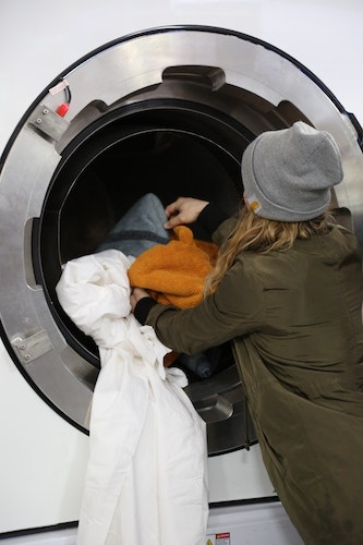 woman loading washer