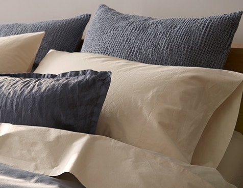 Detail shot of 300 Thread Count Organic Percale Pillowcases in Steel Blue and Undyed