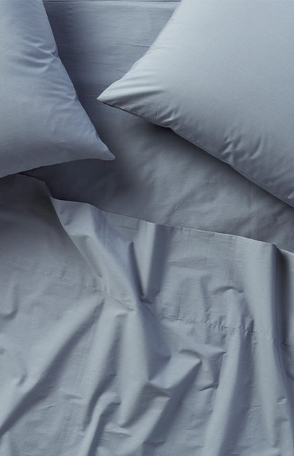Overhead of 300 Thread Count Organic Percale Sheets in Steel Blue