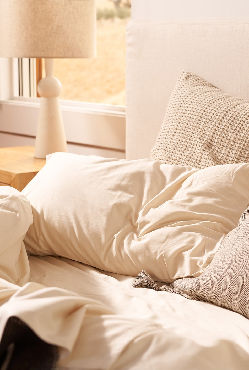 bed made with 300 Thread Count Organic Sateen Sheets