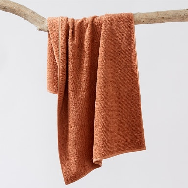 hanging air weight towel in dusty coral