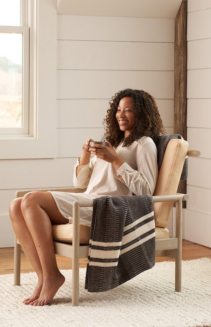 woman sitting in a chair wearing anLaguna Organic Tunic