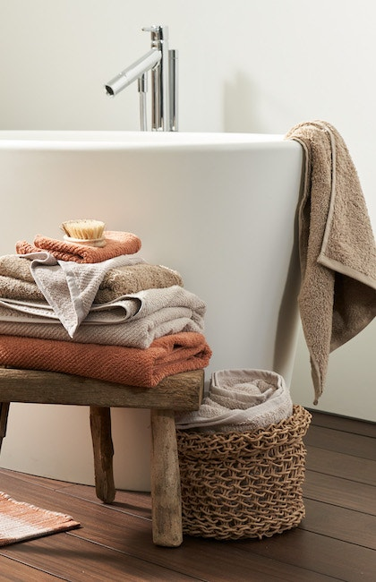 stacked airweight organic towels in a bathrooom