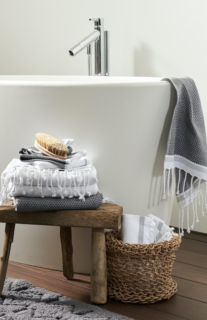 Mediterranean Organic Towels hanging in a bathroom