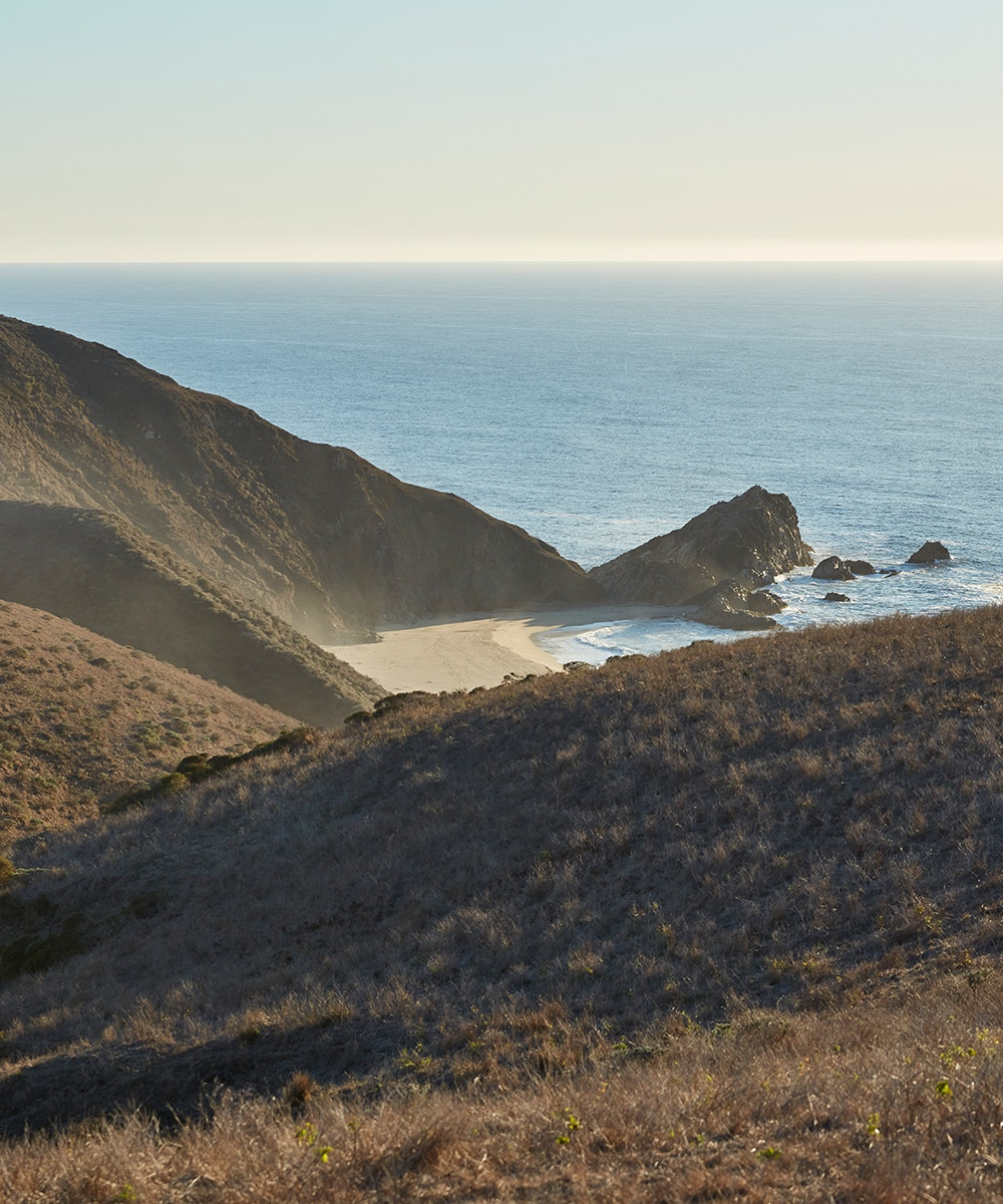 the coastline peeking out between the hills