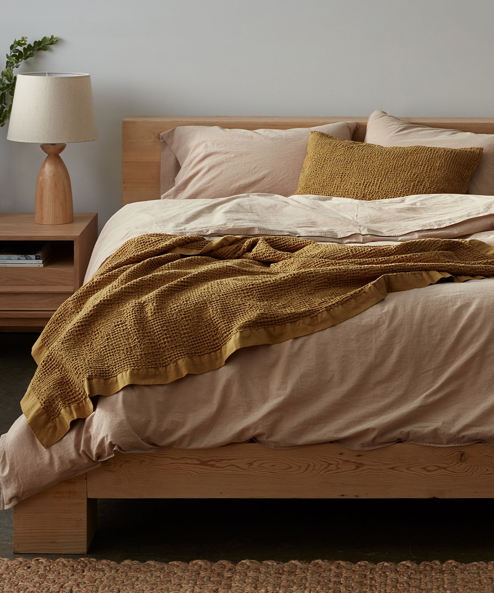 a bed with the hazel Reyes Organic Waffle Blanket