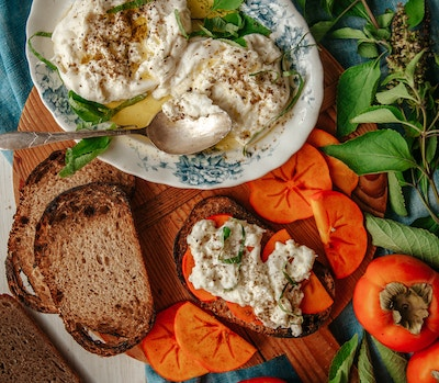 spread of persimmons, bread and dip