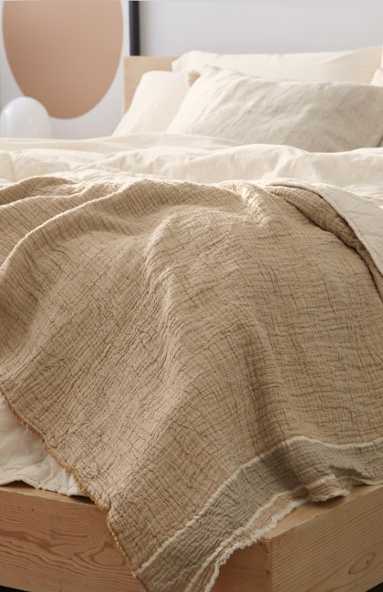 Bed with Topanga Organic Matelasse Blanket