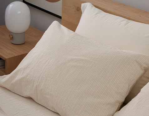 bed made with Organic Crinkled Percale™ Sheets