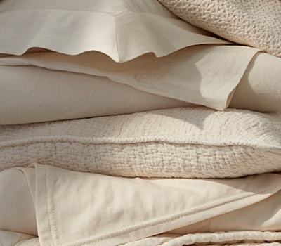 stack of undyed cotton linens