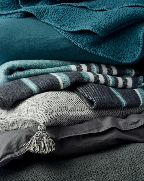 layers of product in grays and aegan colors and patterns