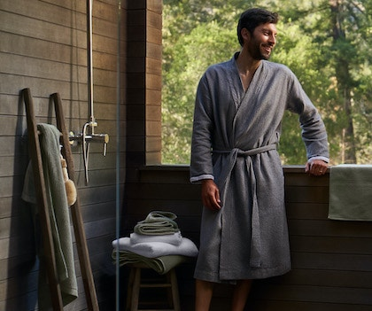 man standing in outdoor shower wearing Unisex Mediterranean Organic Modern Robe