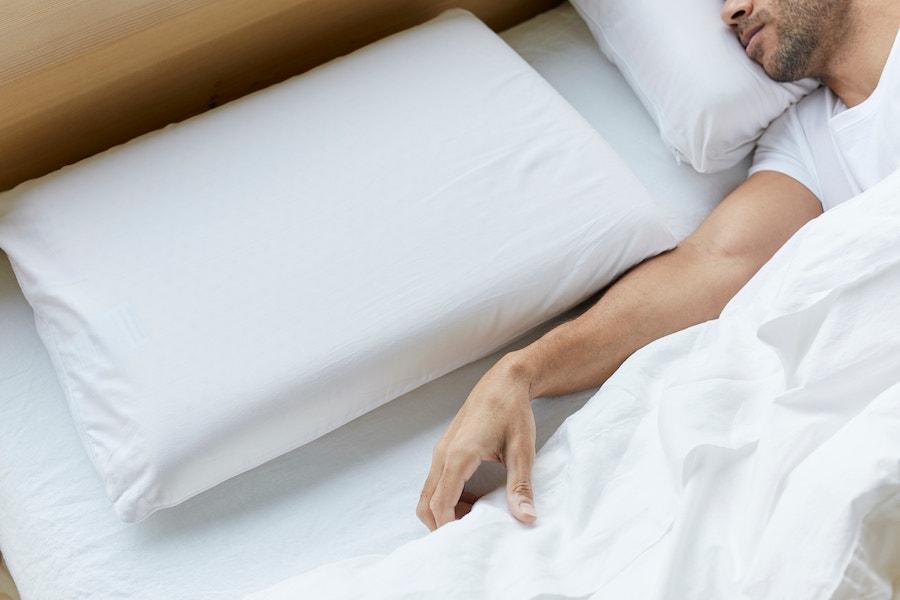 Organic latex pillow on organic sheets