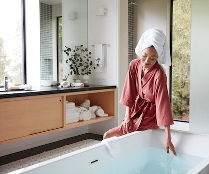 Woman in Solstice Organic Kimono Robe with hair wrapped in an Air Weight Organic Towel