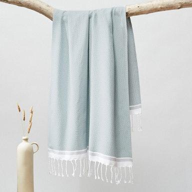 hanging mediterranean organic towels in sea spray