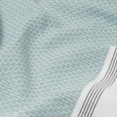 close up detail of mediterranean towel in sea spray