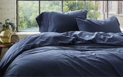 300 thread count organic sateen sheets and duvet on bed