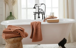 Organic towels decorating bathtub