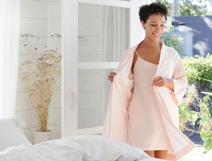 Model wearing Solstice Organic Chemise and Organic Kimono Robe in bedroom