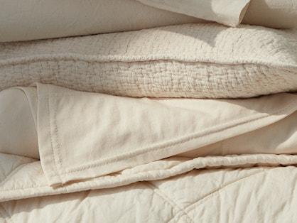 stacked organic bedding and pillow covers