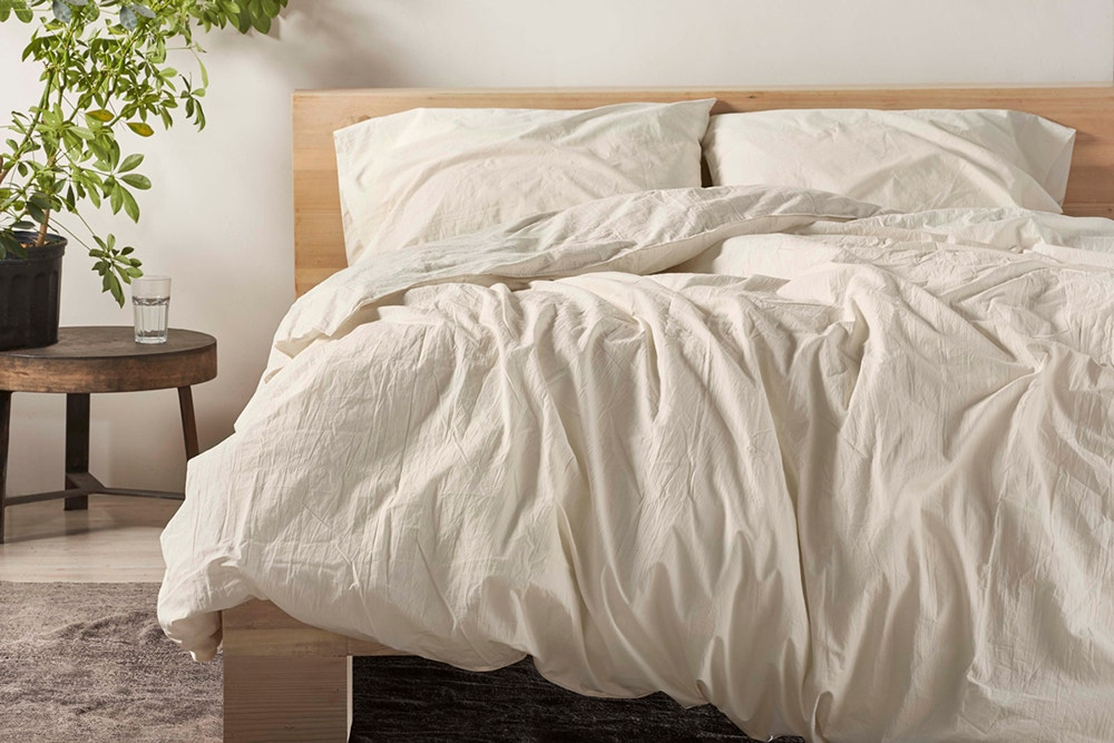 undyed organic crinkled percale minimalist set on a bed