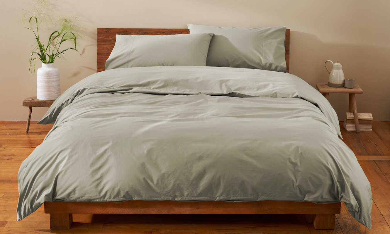 300 thread count organic percale duvet cover and sheets dressed on a bed