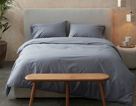 bed made with 300 Thread Count Organic Percale Sheets in Steel Blue