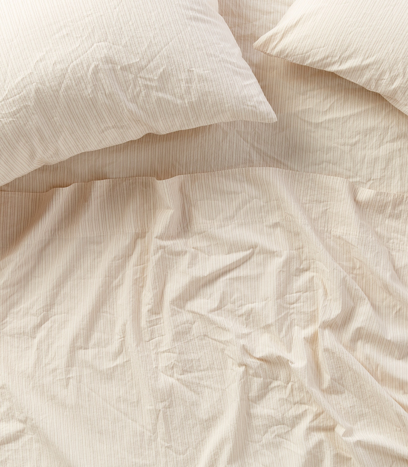 overhead of Organic Crinkled Percale sheets in stripes