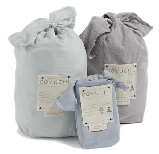 three packaged sheet bags in Coyuchi fabric packaging