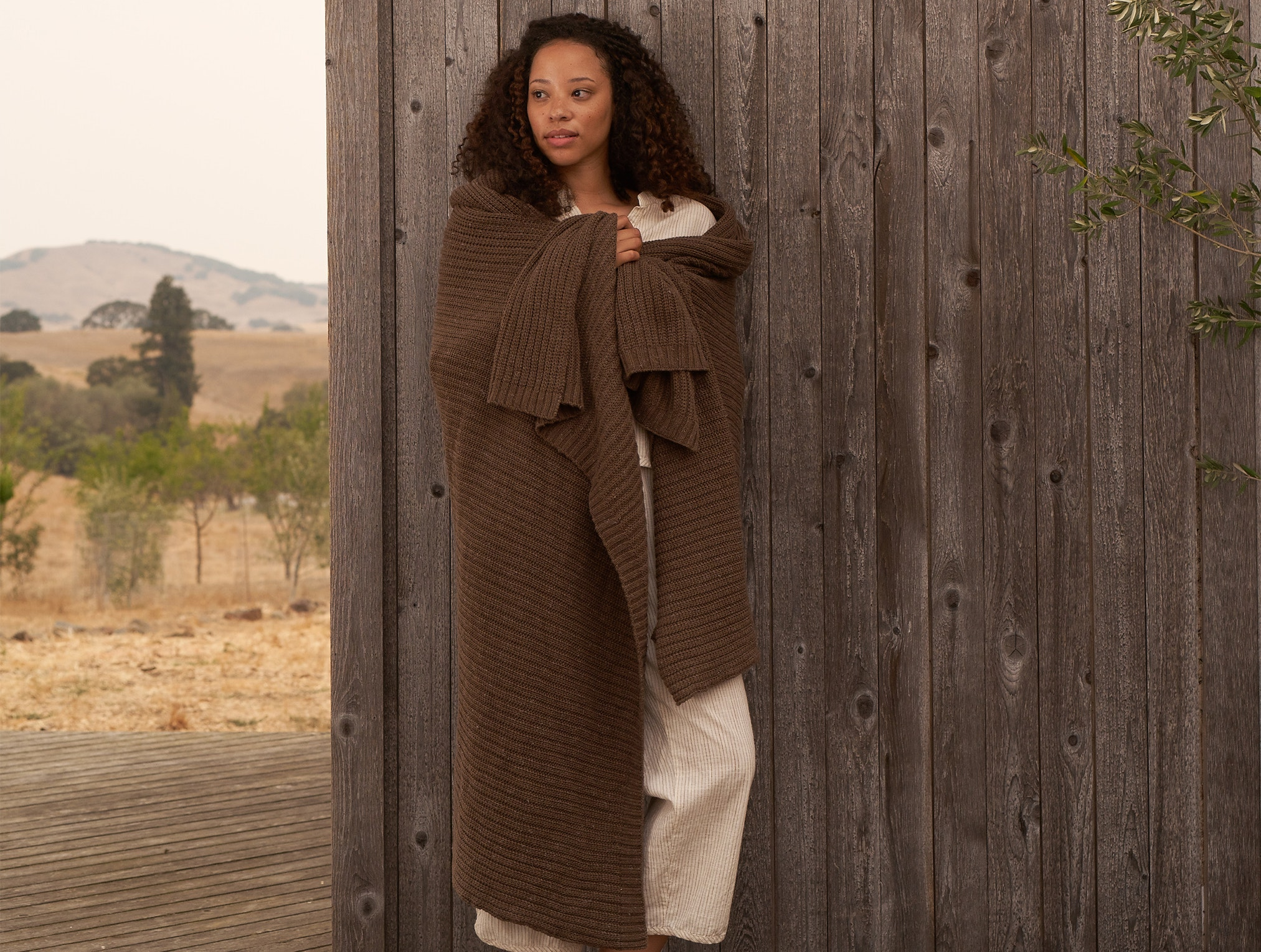 Woman wrapped in a Arroyo Organic Throw