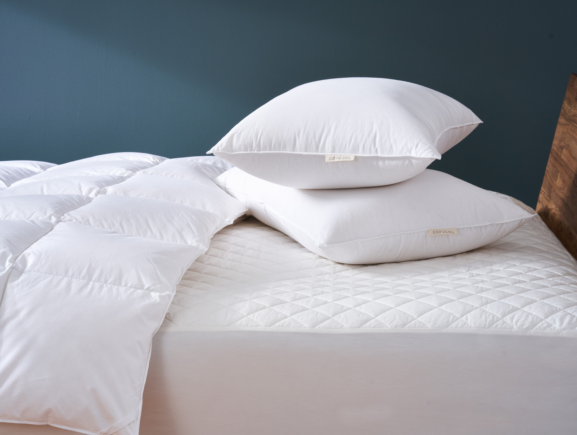 close up of mattress pad on bed