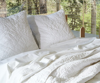 Manzanita Organic Quilt styled with Organic Percale Sheets and a Cascade Organic blanket