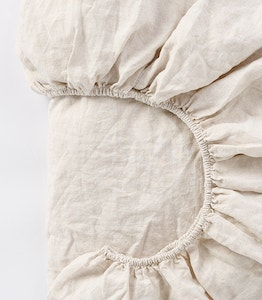 Close up detail of organic linen fitted sheet