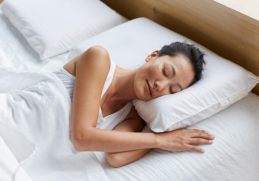 Woman sleeping on the Turiya™ Organic Latex Pillow