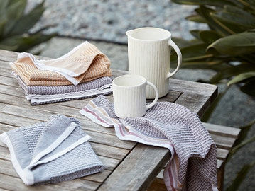textured grid organic kitchen towel wrapped around a tea cup