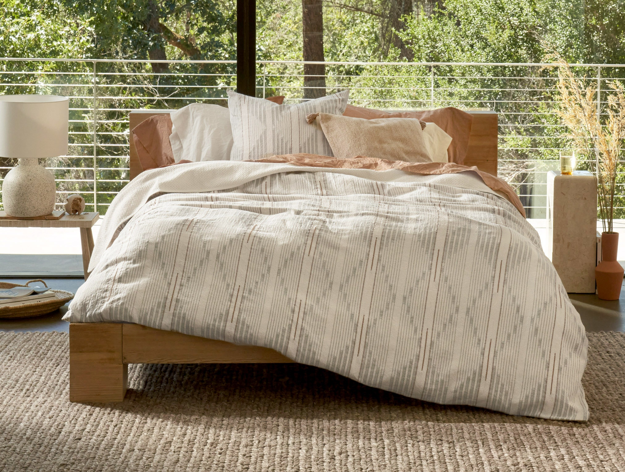 Morelia Organic Duvet Cover styled with Organic Crinled Percale Sheets and Presidio Organic Pillow Cover