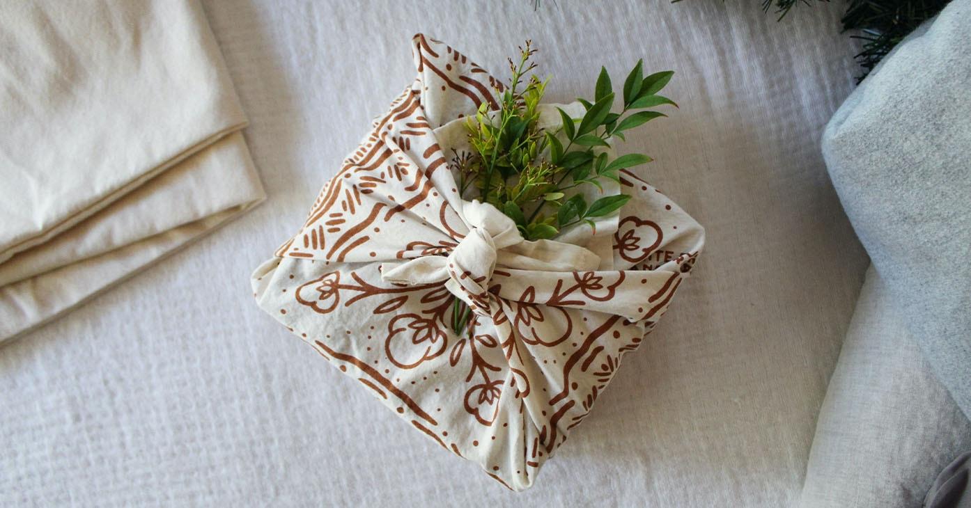 a box wrapped in the White Buffalo Land Trust Bandana Napkin