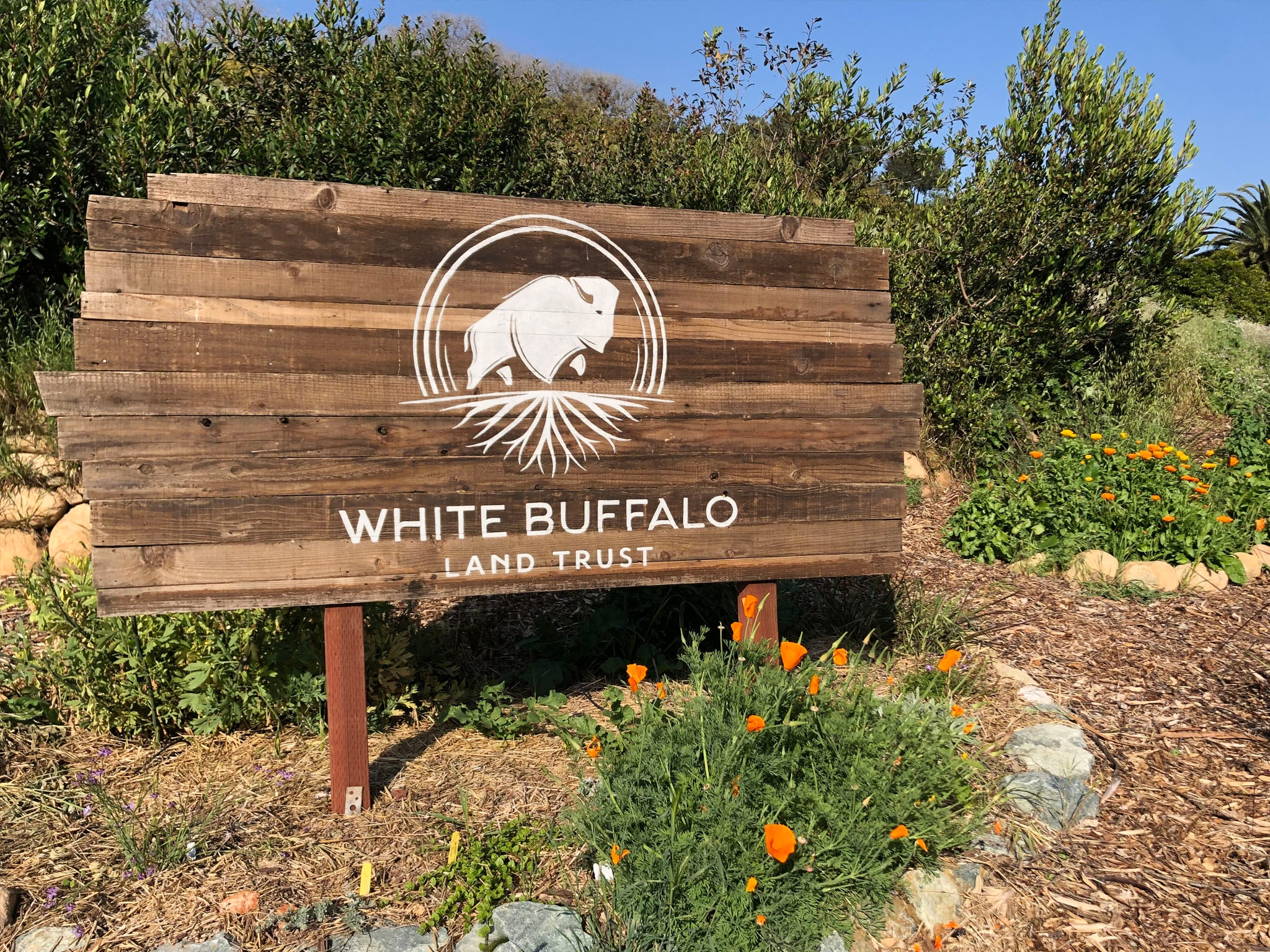 White Buffalo Land Trust sign with logo