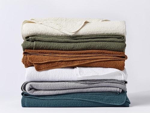 stack of Cascade Organic Matelasse Blankets