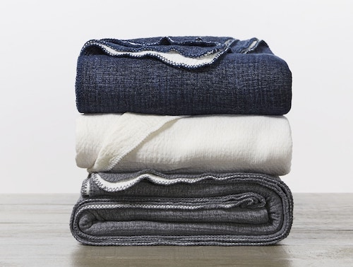 stack of Cozy Cotton Organic Blankets