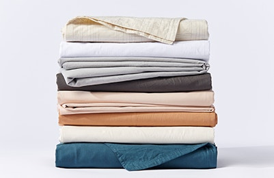 Stack of Organic Crinkled Percale™ Sheets