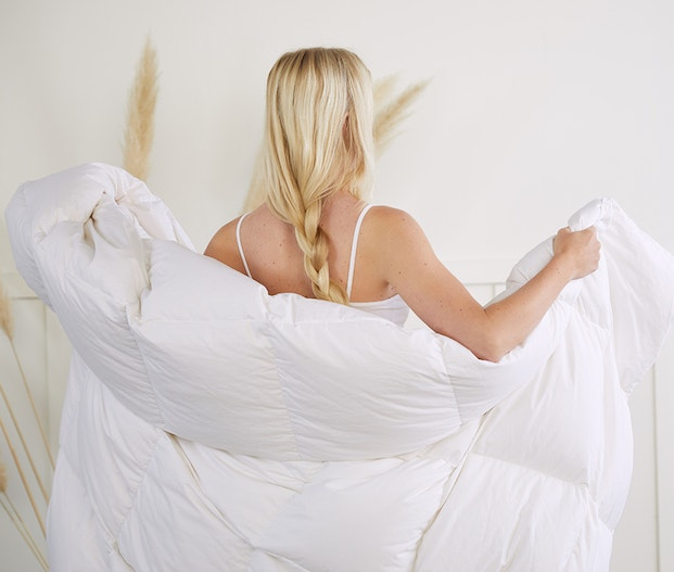 woman with an organic duvet insert draped from her back