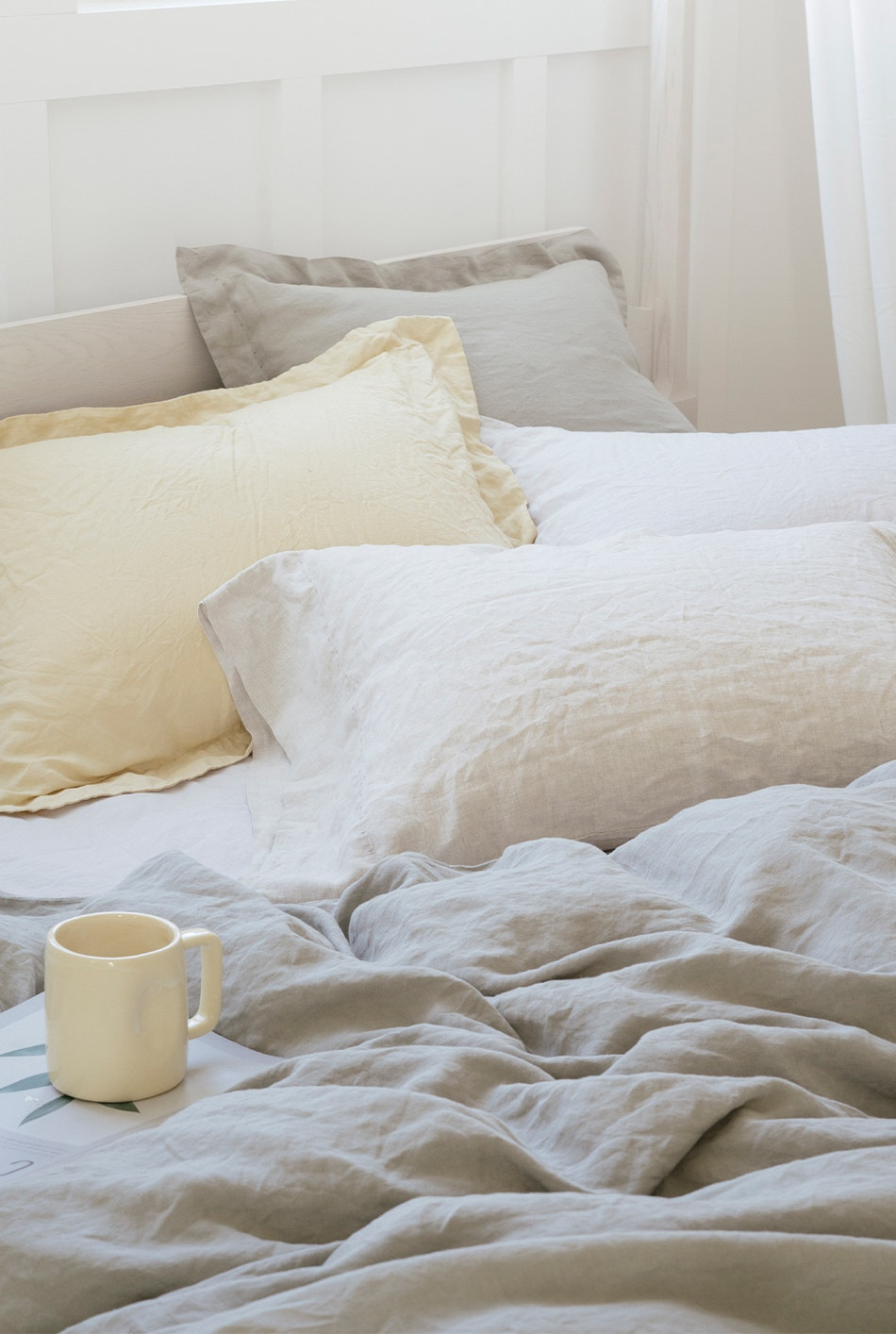 Organic linen sheets and shams on a bed